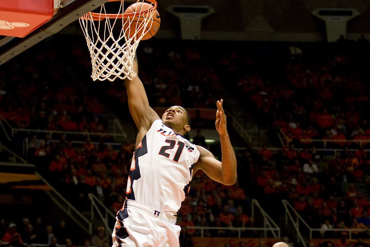 Malcolm Hill dunks in a game against Purdue