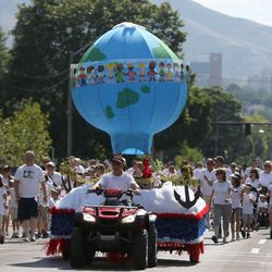 The Sandy Utah Crescent Ridge Stake float moves along the Days of '47 Youth Parade in Salt Lake City on Saturday, July 20, 2013.