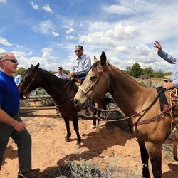 Interior Secretary Ryan Zinke talks with Hank Stevens, Navajo Mountain chapter president representative, and Albert Holiday, Oljato Chapter House vice president ,after hiking to an overlook in the Butler Wash area of the Bears Ears National Monument to view ancient ruins on Monday, May 8, 2017.