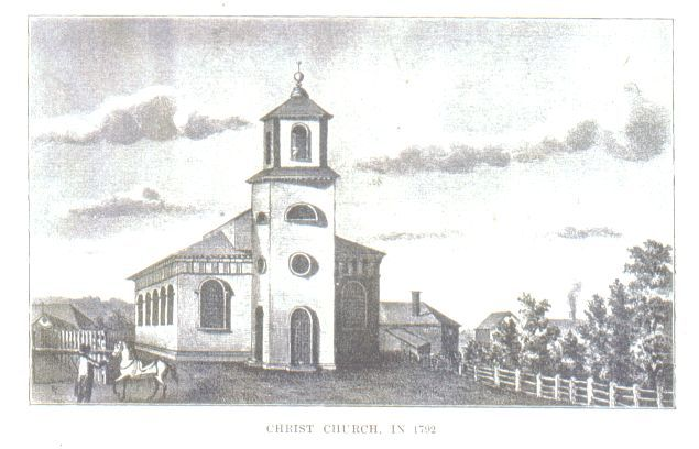 A black-and-white print of an old church on a park.