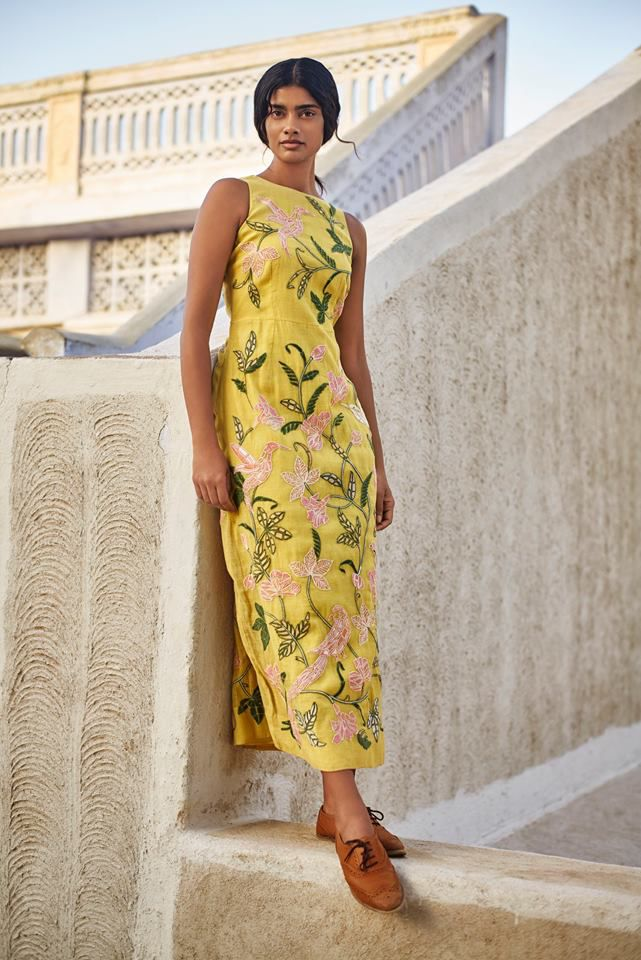 A model in a yellow embroidered dress