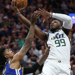 Utah Jazz forward Jae Crowder (99) goes to the hoop over Golden State Warriors guard Nick Young (6) during the game at Vivint Arena in Salt Lake City on Tuesday, April 10, 2018.