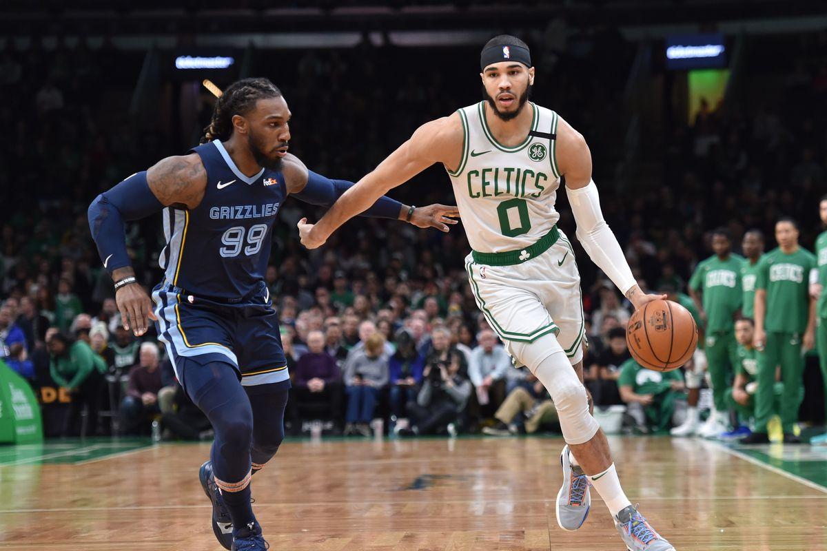 Boston Celtics forward Jayson Tatum controls the ball while Memphis Grizzlies forward Jae Crowder  defends during the first half at TD Garden.