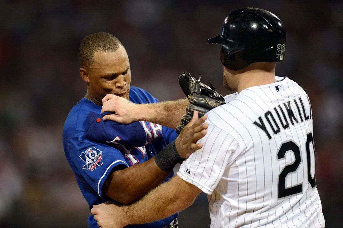 Kevin Youkilis homered, drove in four runs and touched Adrian Beltre's head.