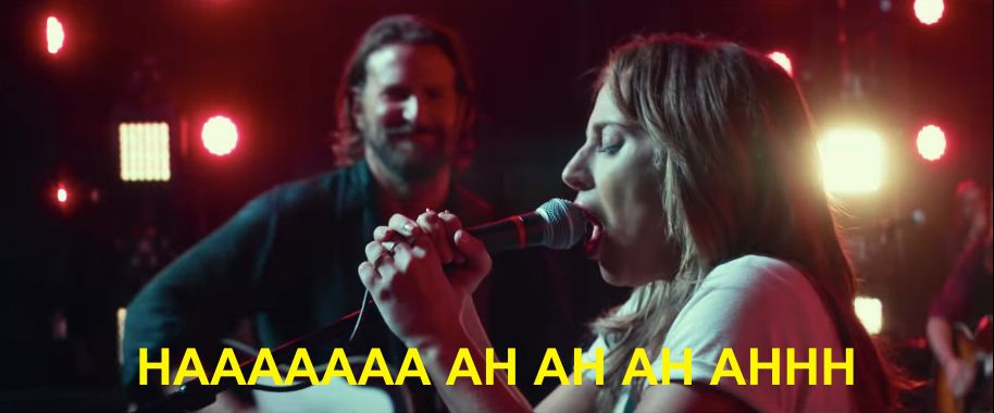 """Lady Gaga signing into a microphone with Bradley Cooper smiling in the background. The caption reads: """"HAAAAAAA AH AH AH AHHH"""""""
