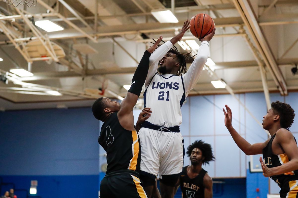 Lincoln Park high school basketball: The Lions outlast Joliet West in overtime