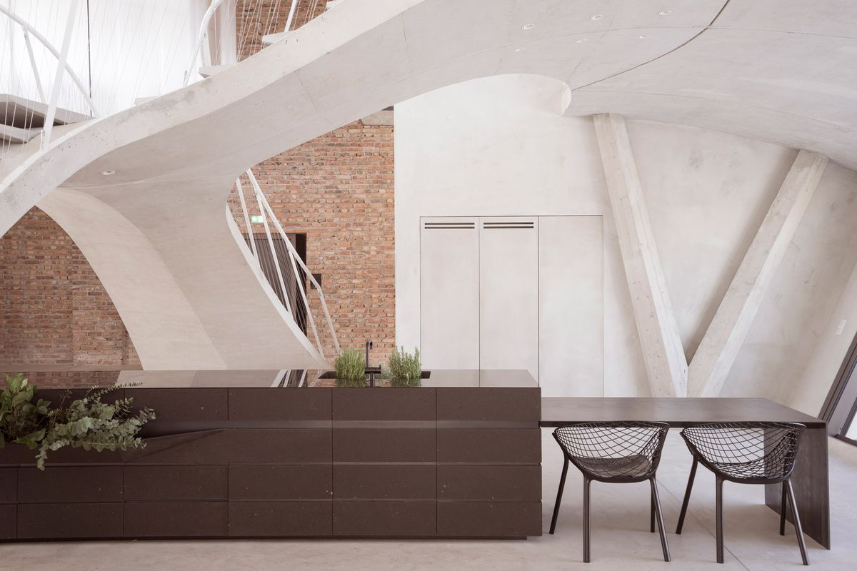 apartment renovation goes for futuristic with sculptural concrete curbed. Black Bedroom Furniture Sets. Home Design Ideas