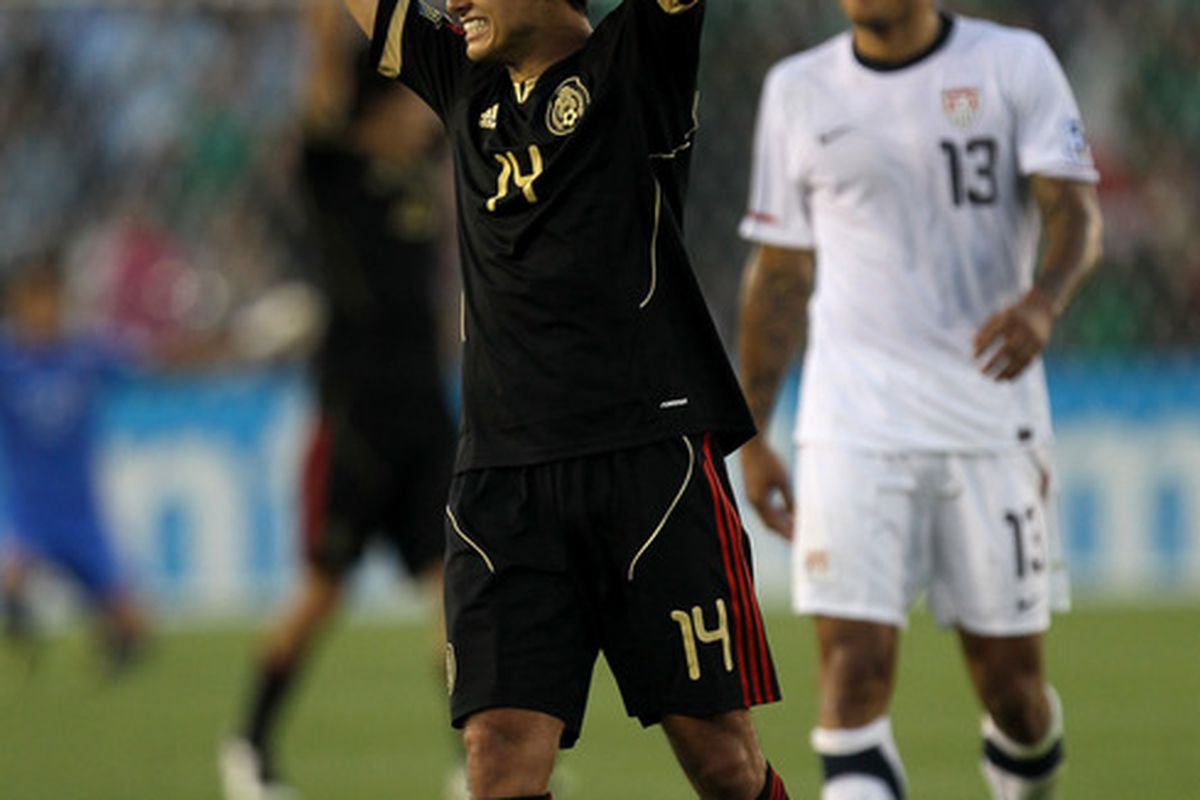 Javier Hernandez #14 (AKA El Chicharito) Mexico celebrates at the end of the game in front of Jermaine Jones #13 of the United States. USA plays Mexico on August 15, 2012. (Photo by Stephen Dunn/Getty Images)