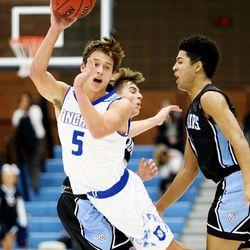 20171214 Bingham's Dax Milne splits the defense of West Jordan's Christian Rhodes-Jimenez and Darrian Nebeker as they play a boys high school basketball game at West Jordan on Wednesday, Dec. 13, 2017. Bingham won 54-50.
