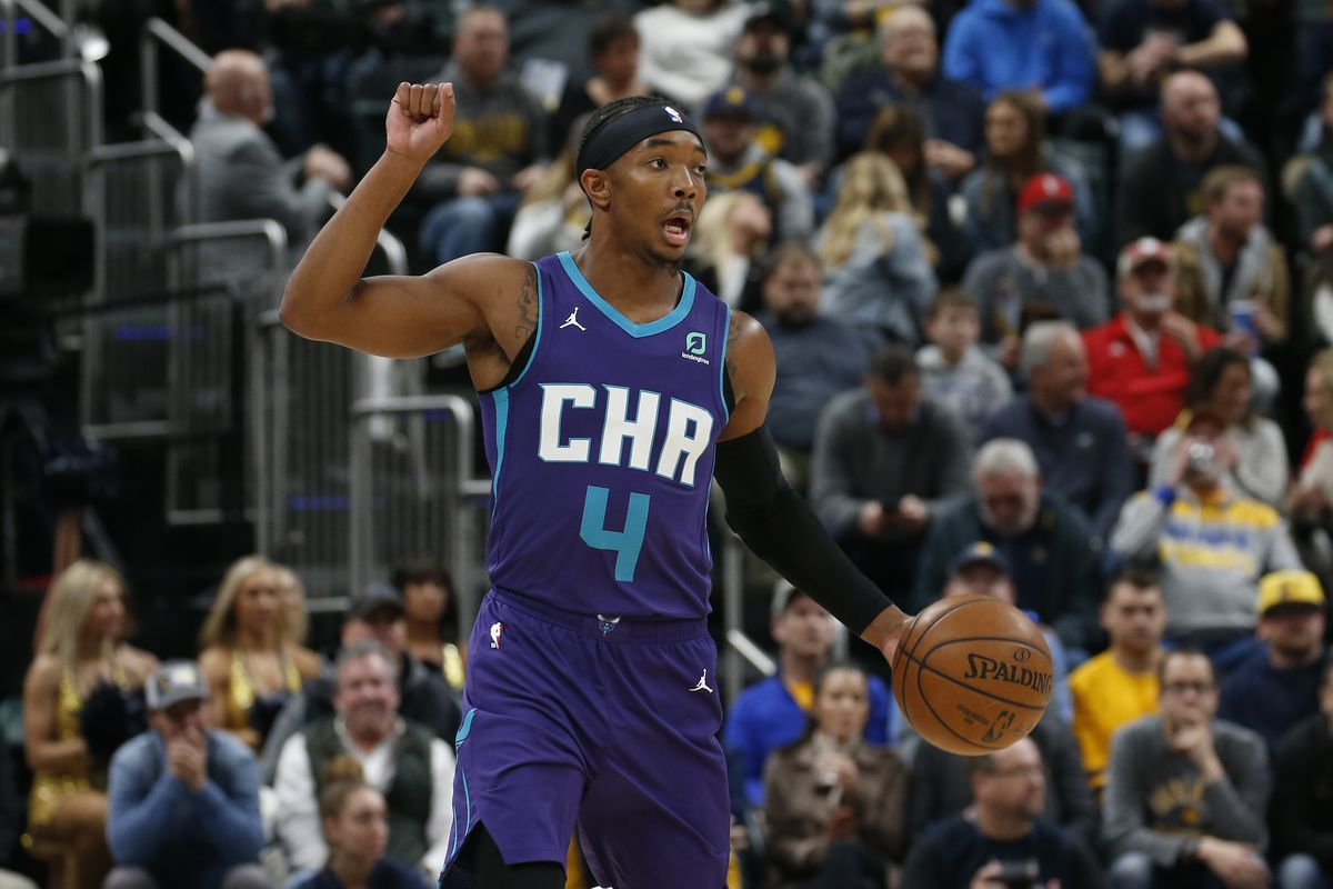 Charlotte Hornets guard Devonte' Graham brings the ball up court against the Indiana Pacers during the first quarter at Bankers Life Fieldhouse.