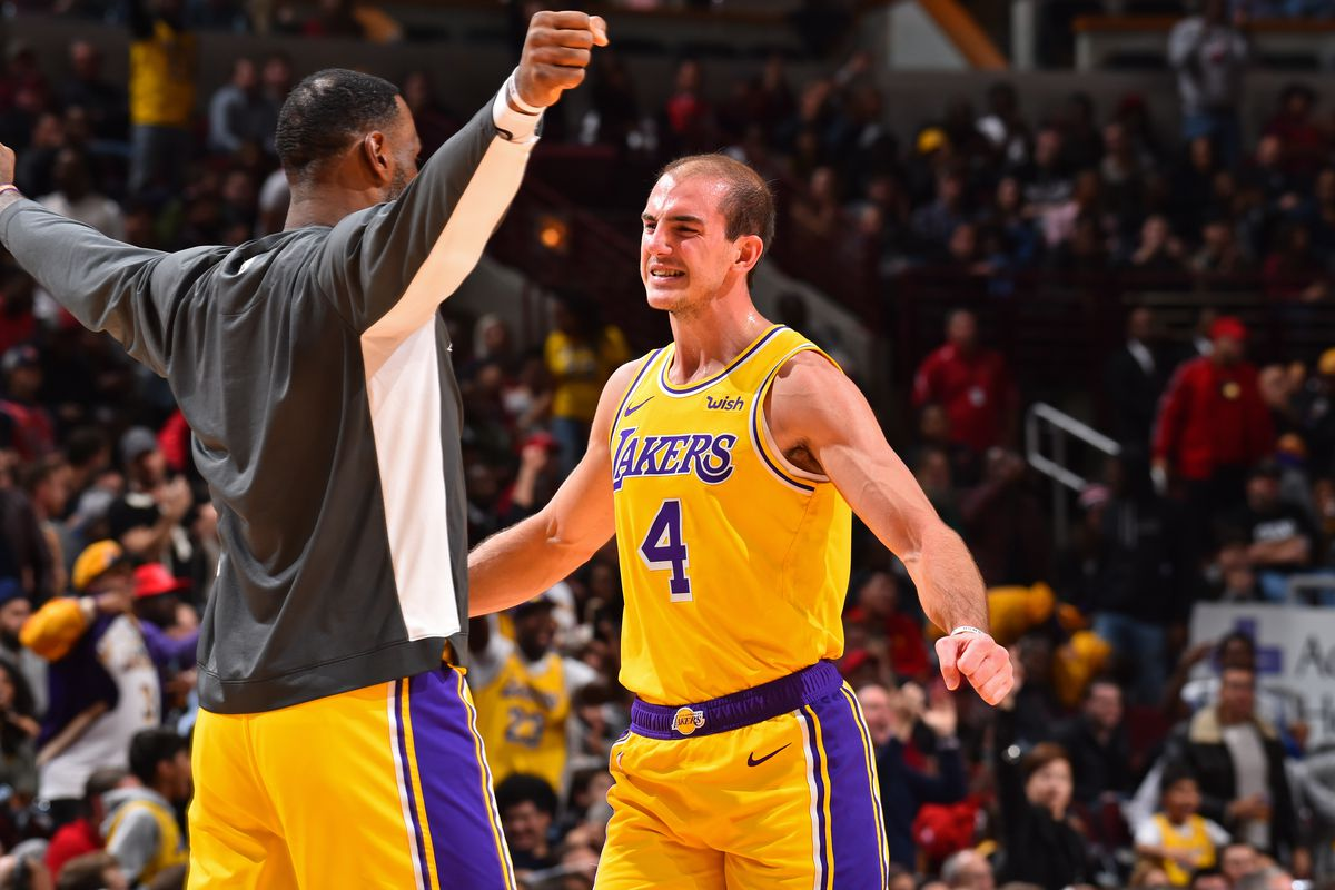 LeBron James, and Alex Caruso of the Los Angeles Lakers react to a play against the Chicago Bulls on November 5, 2019 at United Center in Chicago, Illinois.