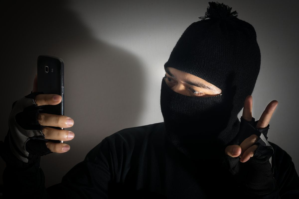 Sorry, stock photo ISIS guy, but you're gonna have a tough time tweeting that selfie.
