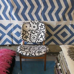 An antique chair recovered in Weinrib's fabric