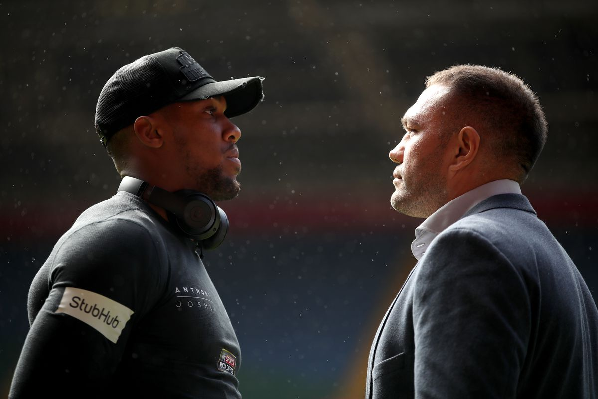 Anthony Joshua (left) and Kubrat Pulev pose for a photo during the press conference at the Principality Stadium, Cardiff.