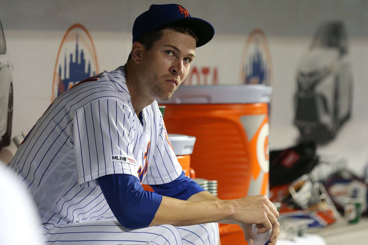 New York Mets starting pitcher Jacob DeGrom reacts in the dugout during the fourth inning against the Colorado Rockies at Citi Field.