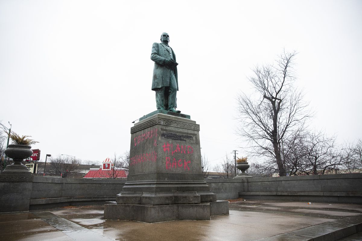 Statue of former president William McKinley was vandalized with graffiti at McKinley Park near the 3700 block of South Archer Avenue in McKinley Park, Wednesday, Nov. 25, 2020.