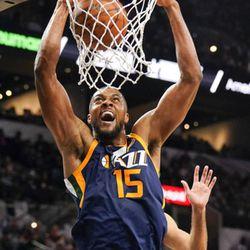 Utah Jazz's Derrick Favors dunks during the second half of the team's NBA basketball game against the San Antonio Spurs, Saturday, Feb. 3, 2018, in San Antonio. Utah won 120-111. (AP Photo/Darren Abate)