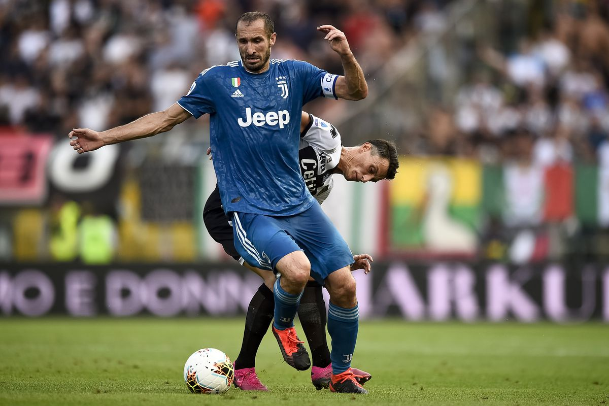 Giorgio Chiellini of Juventus FC competes for the ball with...
