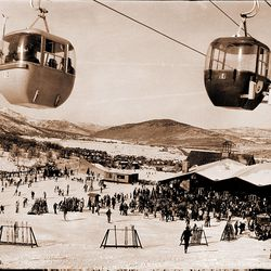 Park City gondola keeps a steady pace hauling skiers to the mountain top while a crowd sunbathes beneath, Dec. 13, 1973.