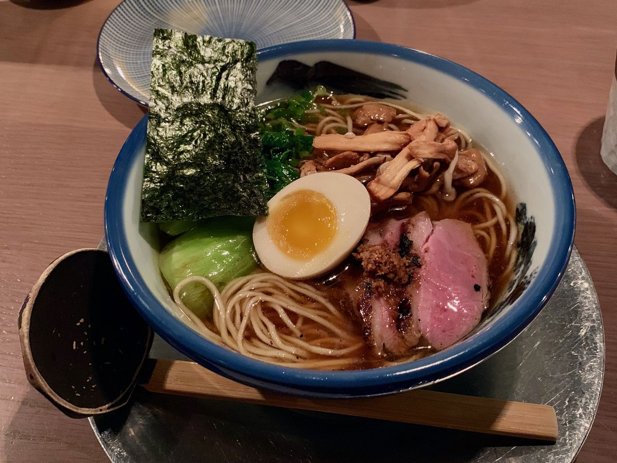 bowl of ramen with half a soft-boiled egg on top