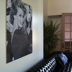 Guess models past and present adorned the walls