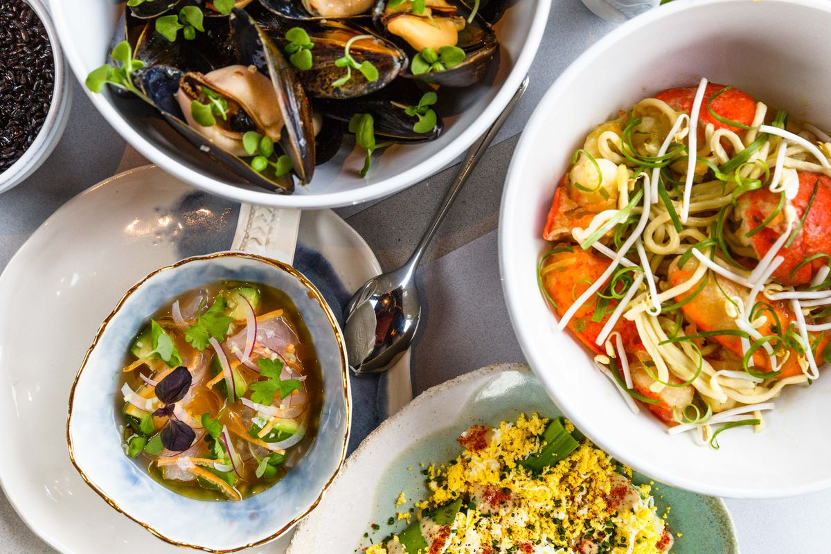Counterclockwise from bottom left: snapper ceviche, white asparagus, longevity noodles, and mussels