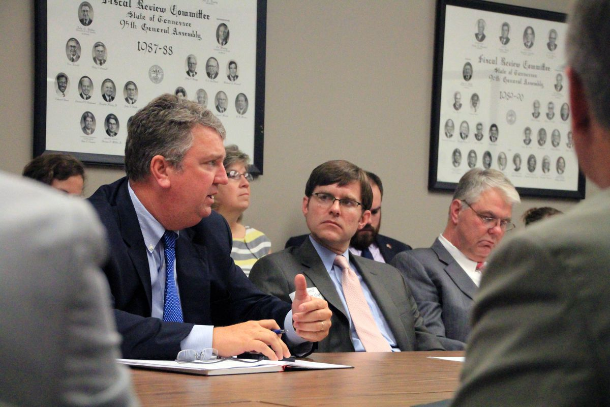 From left: Bartlett City Schools Director David Stephens and Lakeland School System Director Ted Horrell update state legislators on their new districts in 2015.