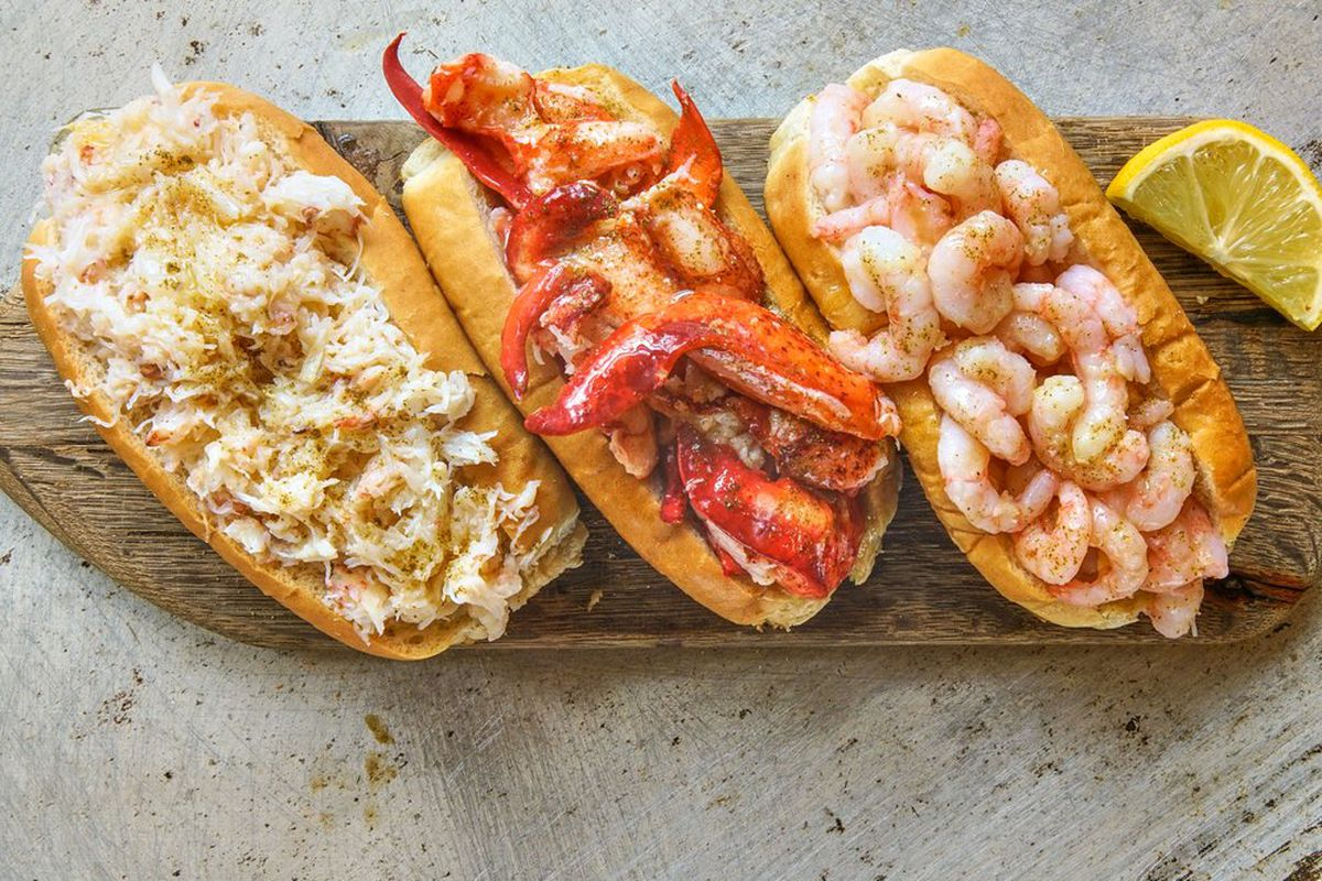 three rolls filled with seafood