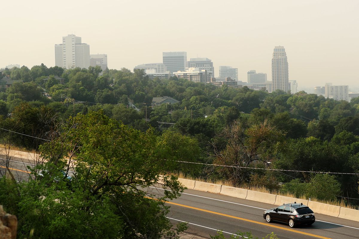 Smoke from wildfires obscures the Salt Lake skyline and the Wasatch Mountains on Monday, Aug. 6, 2018. The smoke is getting so bad around the valleys that the Utah Division of Air Quality is strongly cautioning people with existing heart or respiratory pr