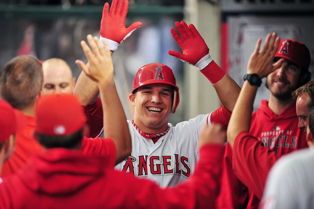 August 28, 2012; Anaheim, CA, USA; Los Angeles Angels center fielder Mike Trout (27) is congratulated after he hits a solo home run in the first inning against the Boston Red Sox at Angel Stadium. Mandatory Credit: Gary A. Vasquez-US PRESSWIRE