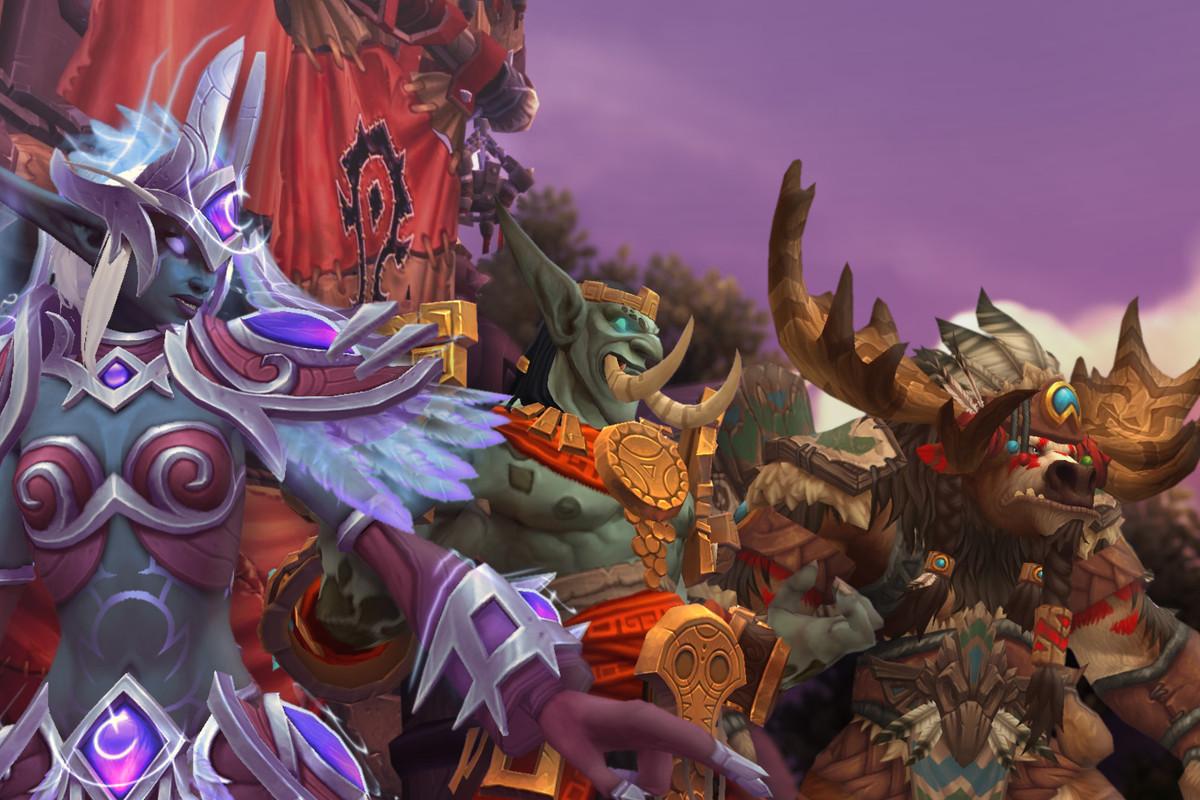 World of Warcraft - a Nightborne elf stands next to a Highmountain Tauren and Zandalari Troll