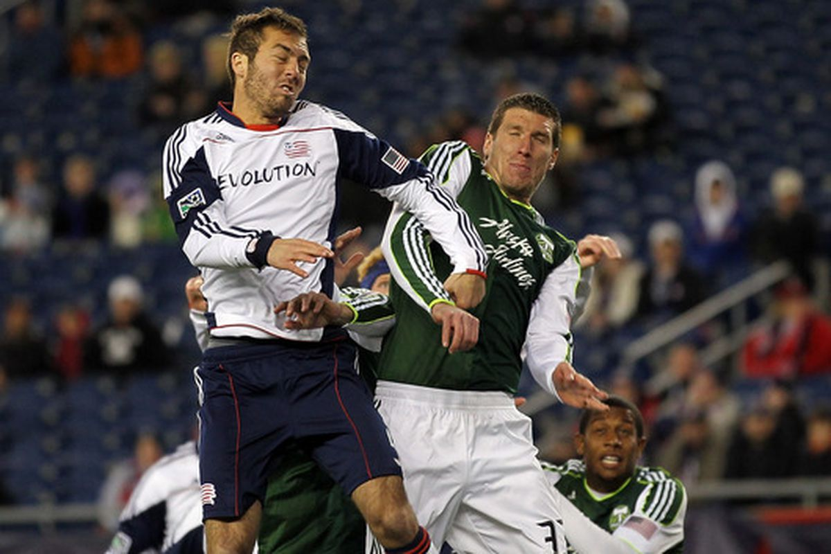 FOXBORO, MA - APRIL 2:  A.J. Soares #5 of the New England Revolution and Kenny Cooper #33 of the Portland Timbers fight for the ball at Gillette Stadium on April 2, 2011 in Foxboro, Massachusetts. (Photo by Jim Rogash/Getty Images)
