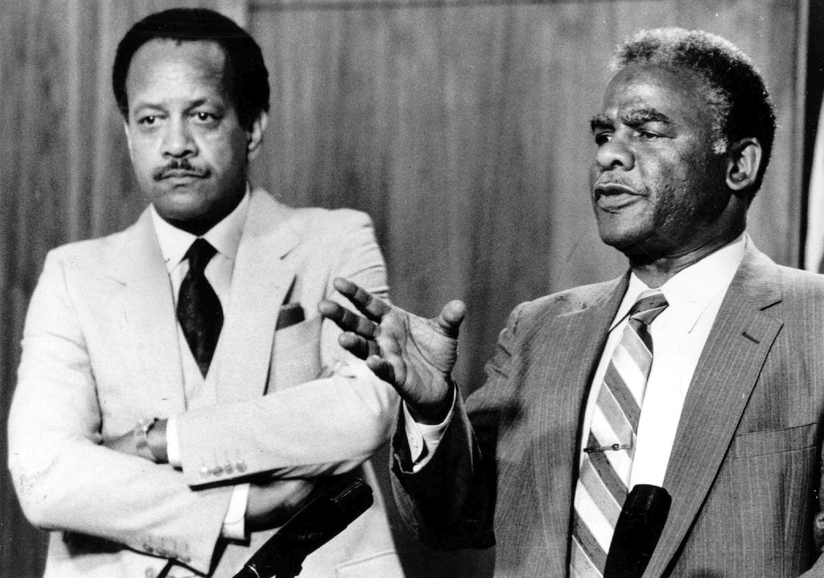 Mayor Harold Washington holds a news conference with then acting City Corporation Counsel James Montgomery in 1983. File Photo.