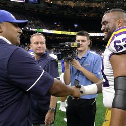 LSU offensive tackle KJ Malone, right, shakes hands with BYU coach Kalani Sitake following the Tigers' 27-0 victory over the Cougars on Saturday, Sept. 2, 2017, at Mercedes Benz Superdome in New Orleans.