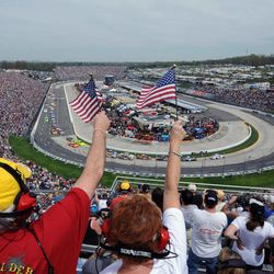 Fans cheer during the opening laps of the NASCAR Sprint Cup Series auto race Sunday, April 1, 2012, in Martinsville, Va.