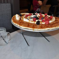 The cinnamon swirl pancake at Herm's Inn comes served on a pizza pan.