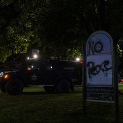Police bearcats sit parked in Civic Center Park during a protest over the shooting of Jacob Blake, Tuesday, Aug. 25, 2020, in Kenosha, Wis.