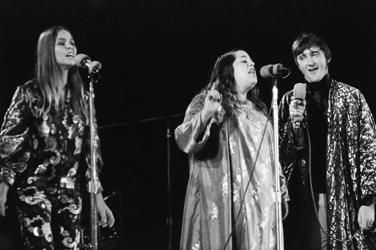 Michelle Phillips (left), Mama Cass and Denny Doherty of The Mamas & the Papas performing