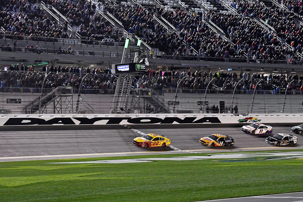 NASCAR Cup Series driver Joey Logano crosses the finish line to win the Gander RV Duel 2 at Daytona International Speedway.