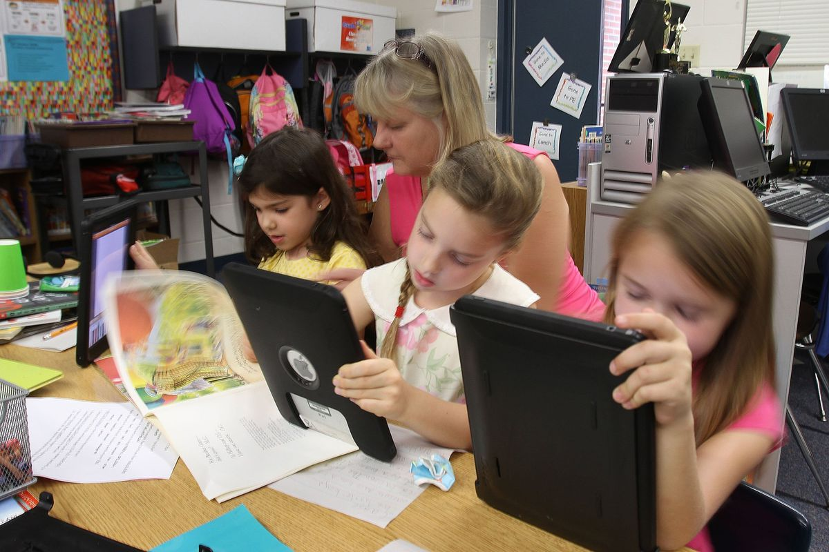A teacher works with students in Orlando, Florida.