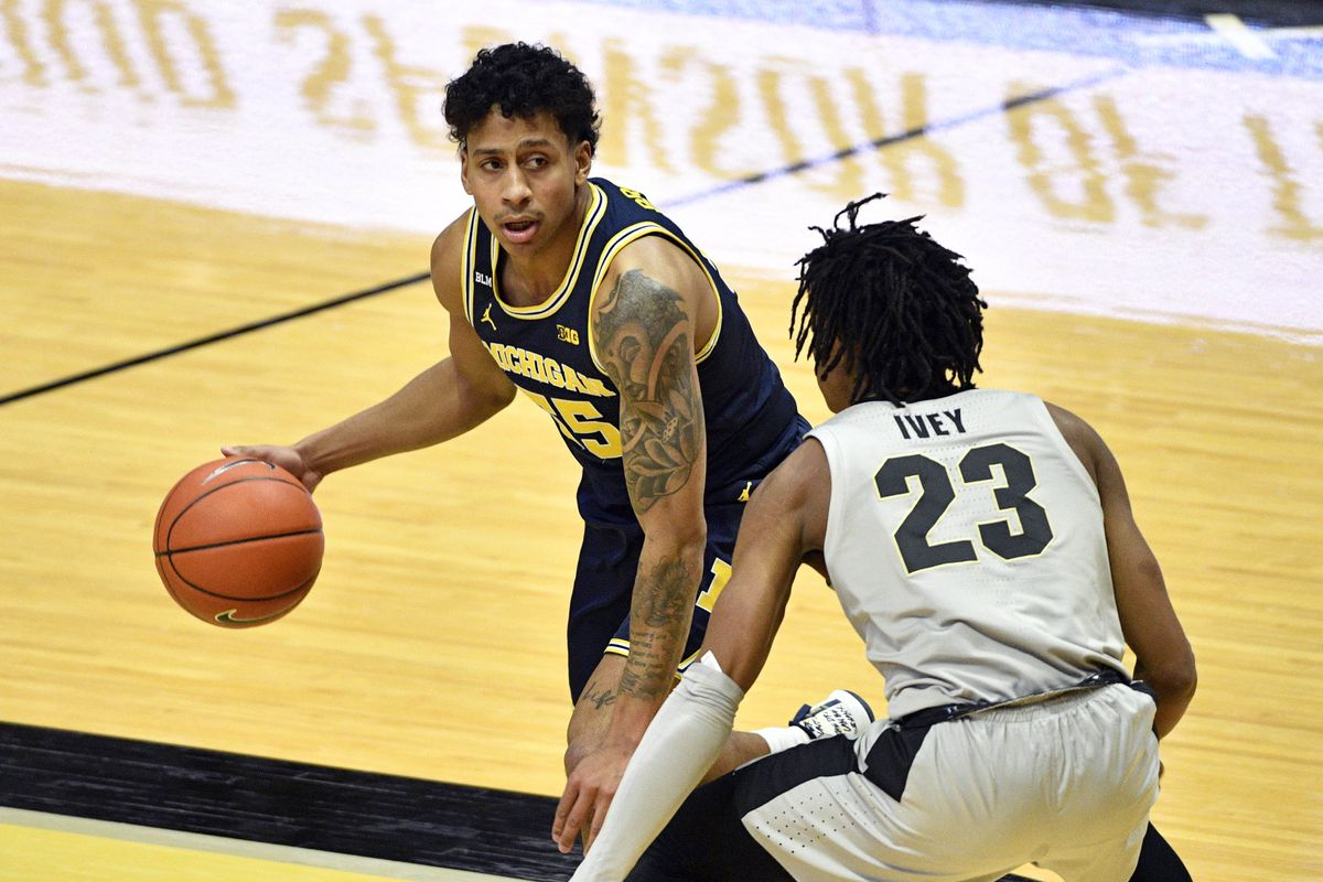 Michigan Wolverines guard Eli Brooks (55) looks for an opening around Purdue Boilermakers guard Jaden Ivey (23) during the second half of the game at Mackey Arena.