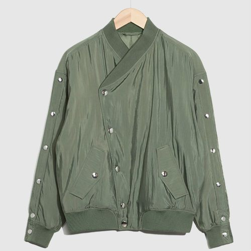 Army green bomber jacket with overlapping sides and silver metal detailing.