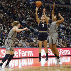 Notre Dame's Marina Mabrey (3) shoots in front of UConn's Napheesa Collier (24) and Katie Lou Samuelson (33) during the Notre Dame Fighting Irish vs UConn Huskies women's college basketball game in the Women's Jimmy V Classic at the XL Center in Hartford, CT on December 3, 2017.