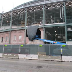 Two hours later, the office facades are being demolished, too