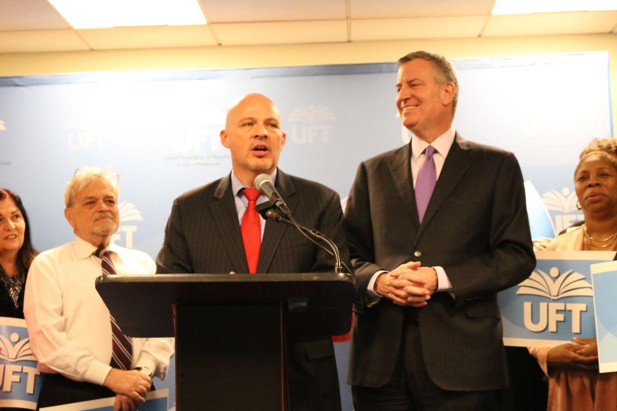 United Federation of Teachers President Michael Mulgrew, center, and Mayor Bill de Blasio