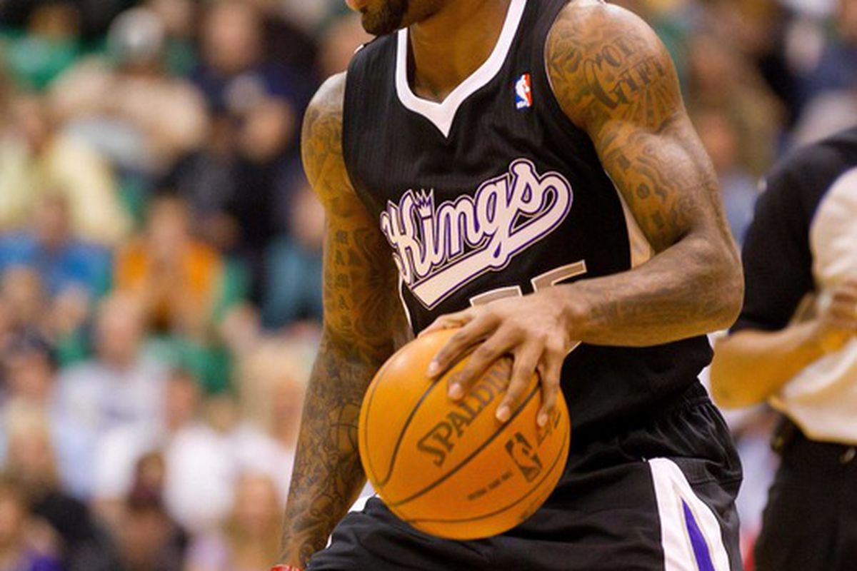 March 30, 2012; Salt Lake City, UT, USA; Sacramento Kings point guard Terrence Williams (55) dribbles up court during the first half against the Utah Jazz at Energy Solutions Arena. Mandatory Credit: Russ Isabella-US PRESSWIRE