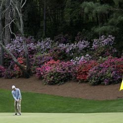 FILE - This April 7, 2009 file photo shows Nick Watney putting on the 13th green during his practice round for the Masters golf tournament in Augusta, Ga. Augusta National has lost its color. Due to an unusually warm spring, the azaleas and dogwoods already have bloomed. The Masters has gone green.