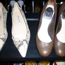 A pair of youthful looking Manolos next to Dior pumps