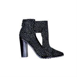 """<a href=""""http://www.tibi.com/shop/perla-boot-black-multi"""">Perla boot</a>, $161 (were $575)"""
