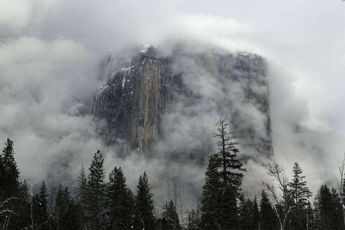 In this Feb. 20, 2019, file photo, fog covers the El Capitan landmark in Yosemite National Park, Calif.